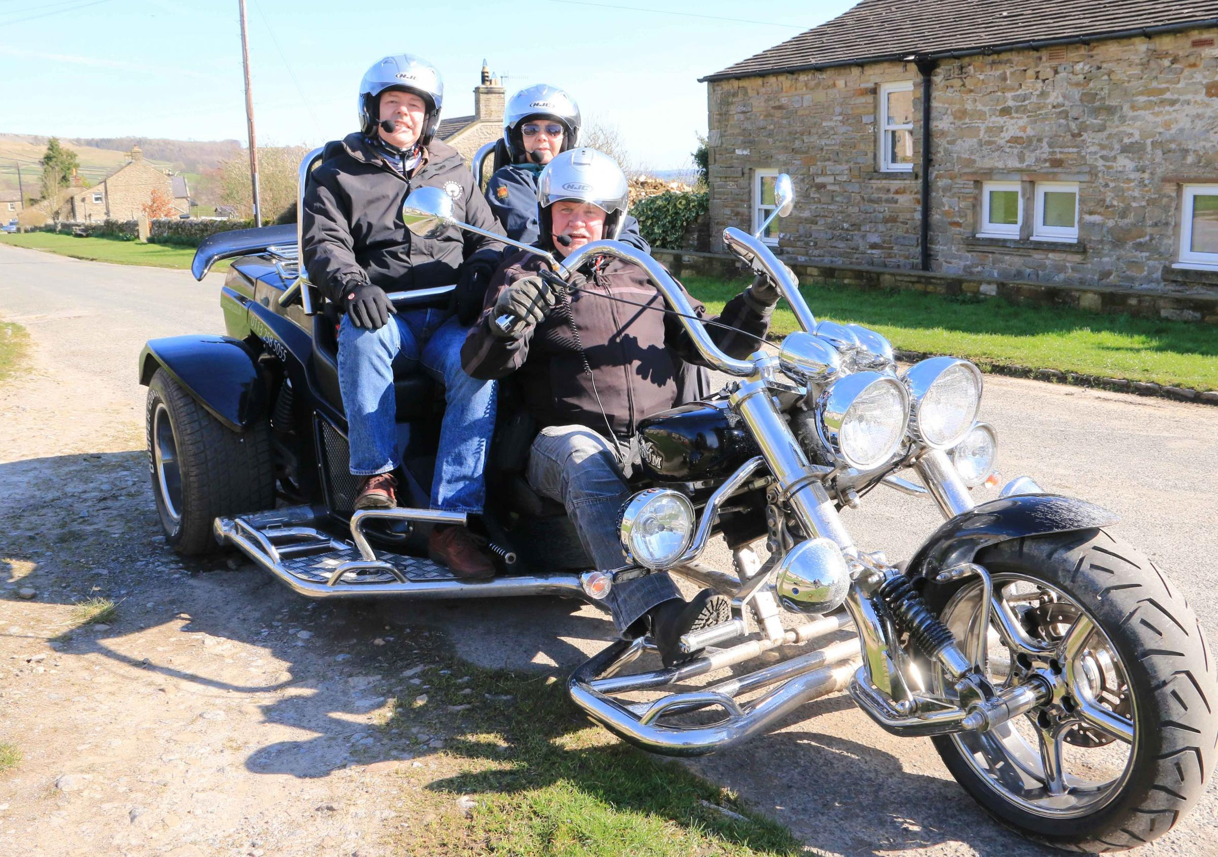 TRIKE: Bringing tourists to the Dales is Jason Richards with Stephen and Charmaine Strake-Purvis celebrating a birthday. Picture: PHILIP SEDGWICK