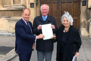 "(left to right) Kevin Hollinrake MP, Peter Lawrence and Baroness Hamwee holding a copy of Claudia's Law, as the father of missing chef Claudia Lawrence has spoken of his ""delight"" as new laws to help the families of missing people cleared Pa"