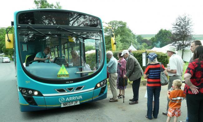 EXTENDED: Passengers alighting a Moorsbus at Danby Picture: Moorsbus.