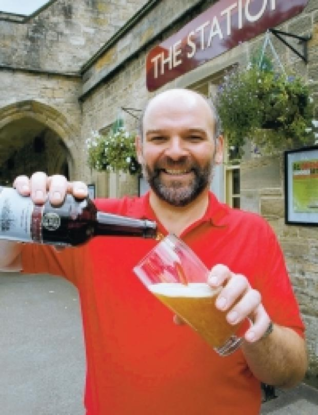 CHEERS: Andy Hamilton, master brewer, moves into The Station