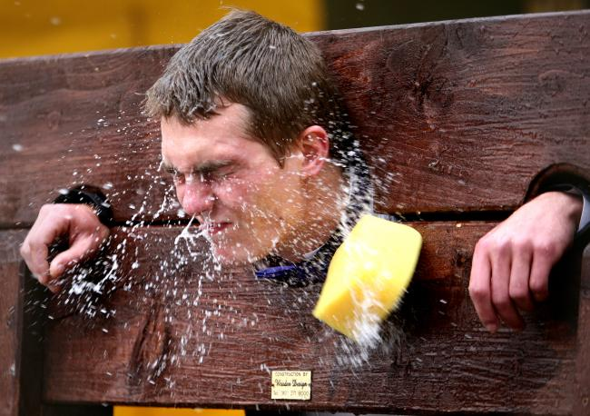 To mark the Feast of St Michael pupils got to 'Sponge the Teacher' while they were in stocks, like this picture