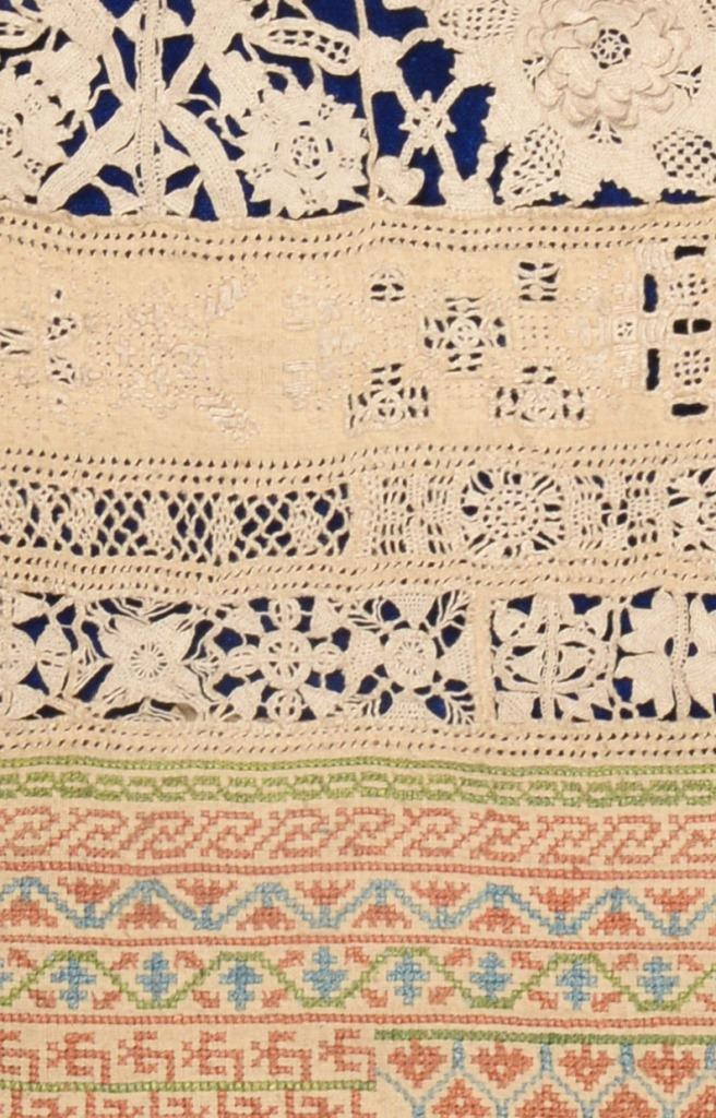 Detail from one of the fine linen samplers dating back to the 17th century