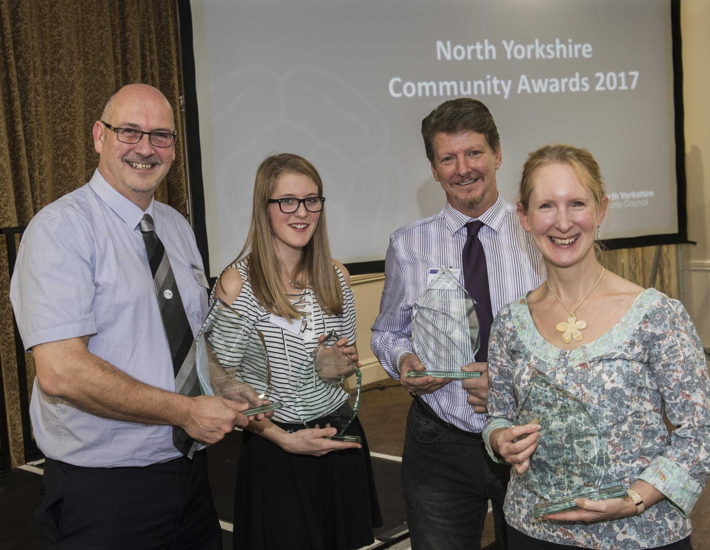 WINNERS: Last year's Community Awards winners. From left, Colin Eastwood of Yorkshire Coast Sight Support, Catherine Sawyer from Settle Stories, Kevin Axelby of Men in Sheds and Su Morgan of Tadcrafters
