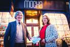 LOYAL: Bob Woodings, winner of the first prize in the 2017 Loyalty Card promotion receives his prize from chair of the RBTA, Marcia McLuckie. Picture: Guy Carpenter.