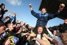 GOING UP: Martin Gray is held aloft after Darlington had won the Northern League title at the end of the 2012-13 season, the first of three promotions in five full seasons