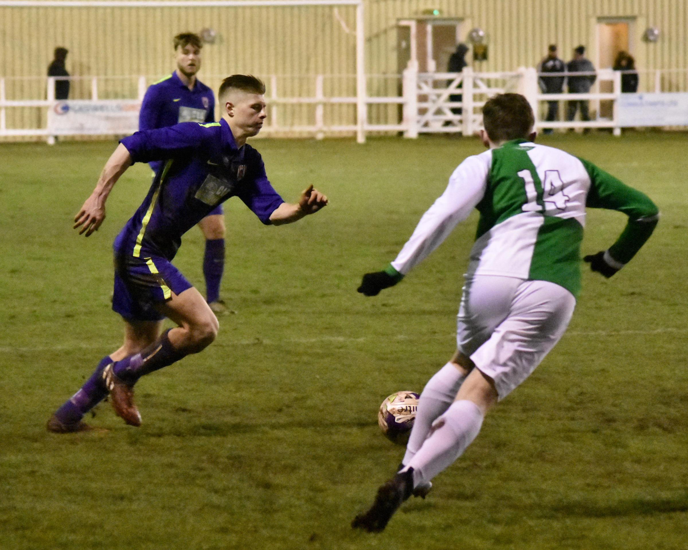 Bradley Mills shows the defender in full flight in competition with a Billingham attacker