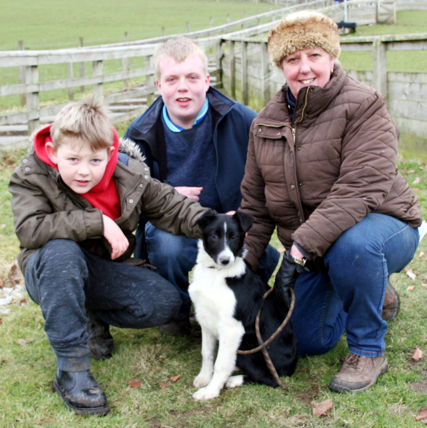 Shaun Procter, centre, with his 1,600gns top price pup, Ann, with buyer Caroline Hamilton, and nine-year-old David Mellor, whose mother, Rebecca Spooner, bought the top price 8,100gns broken dog.