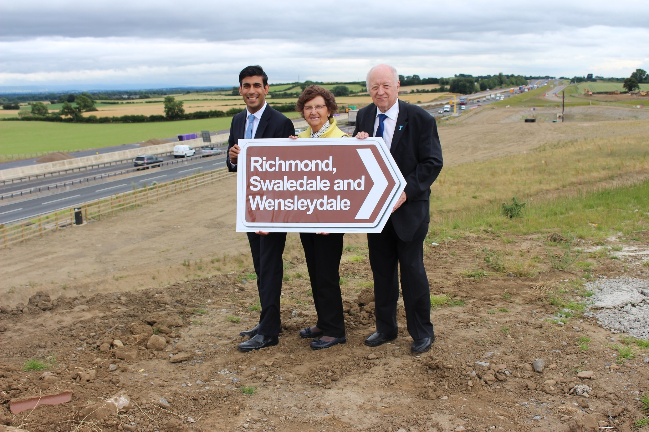SIGNS: Rishi Sunak, Yvonne Peacock and Carl Les have won their fight to get tourism signs installed on the upgraded A1.