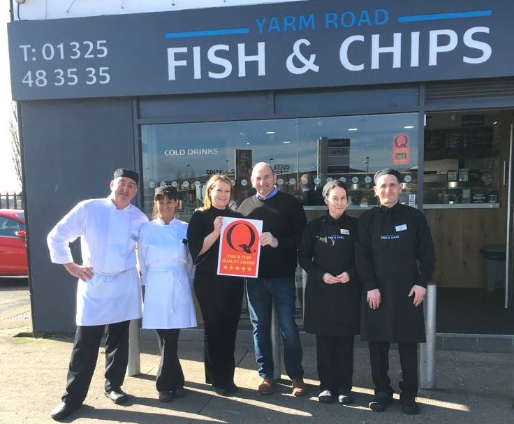 Staff from Yarm Road fish shop receiving their award