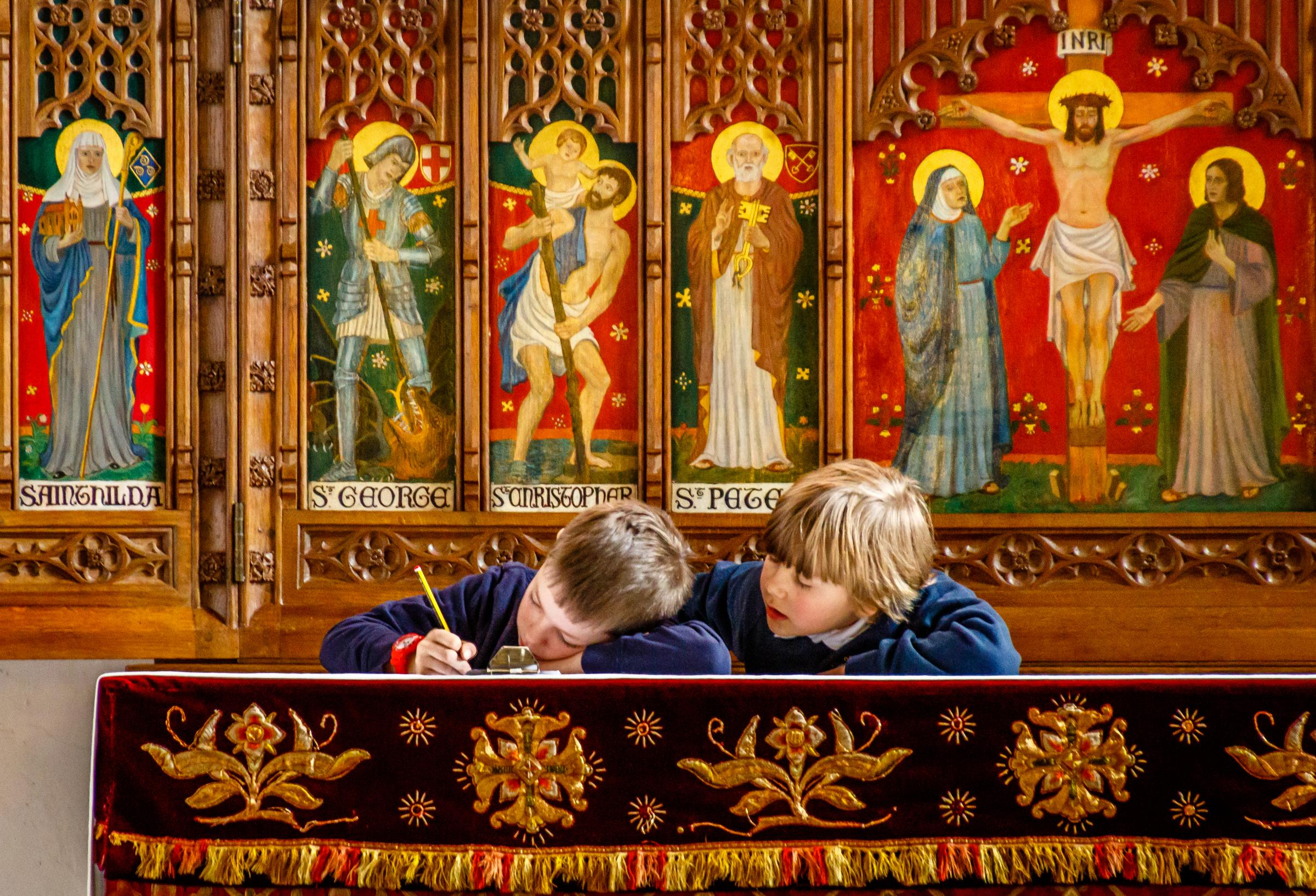 Pupils attempt to work out the children's trail quiz at St Mary's Church, Richmond. PICTURE: Martin Haywood