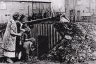 BOMBING: A family with their air raid shelter in Newcastle. Picture: NEWCASTLE CITY LIBRARY