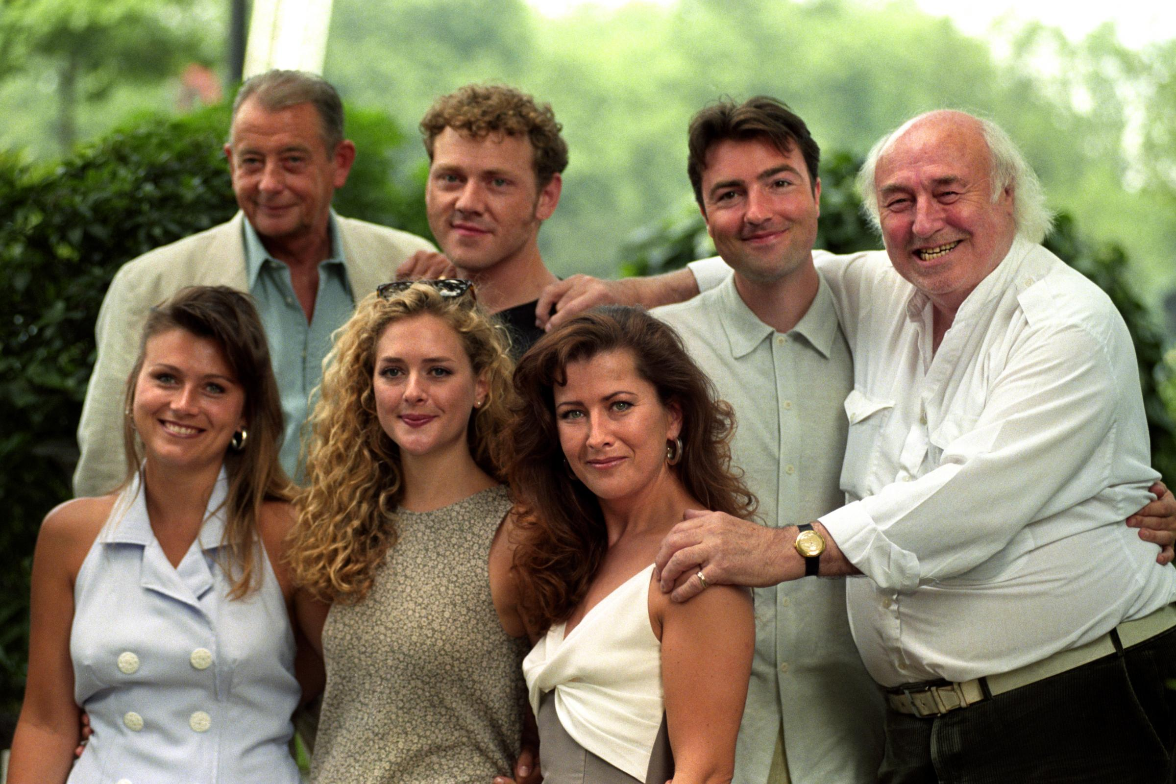 Heartbeat cast, top from left, Derek Fowlds (Sgt Blaketon), Mark Jordon (PC Bellamy), Nick Berry (PC Nick Rowan), and Bill Maynard (Claude Jeremiah Greengrass). Front row, from left, is Tricia Penrose (Barmaid Gina), Juliette Gruber (Jo Weston) and Kazia