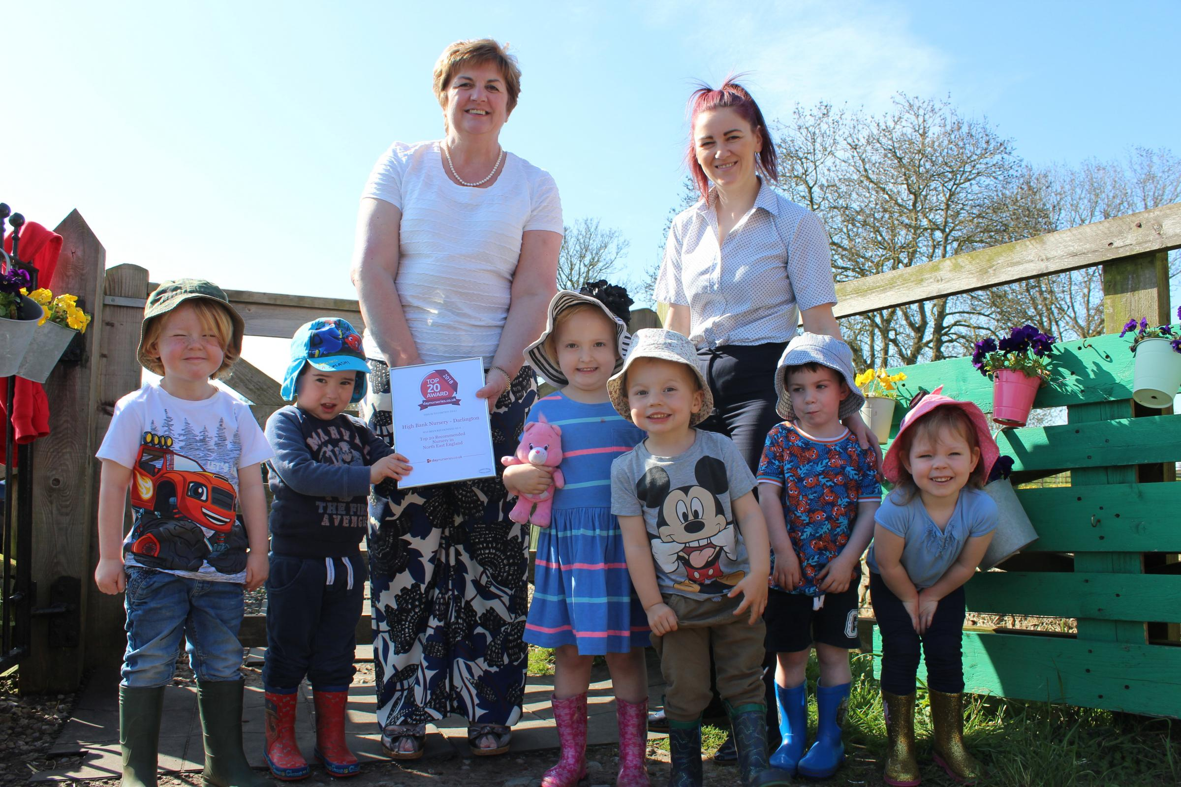 AWARD: High Bank owner Lesley Thompson (left) with manager Hayley Grainger and some of the nursery children