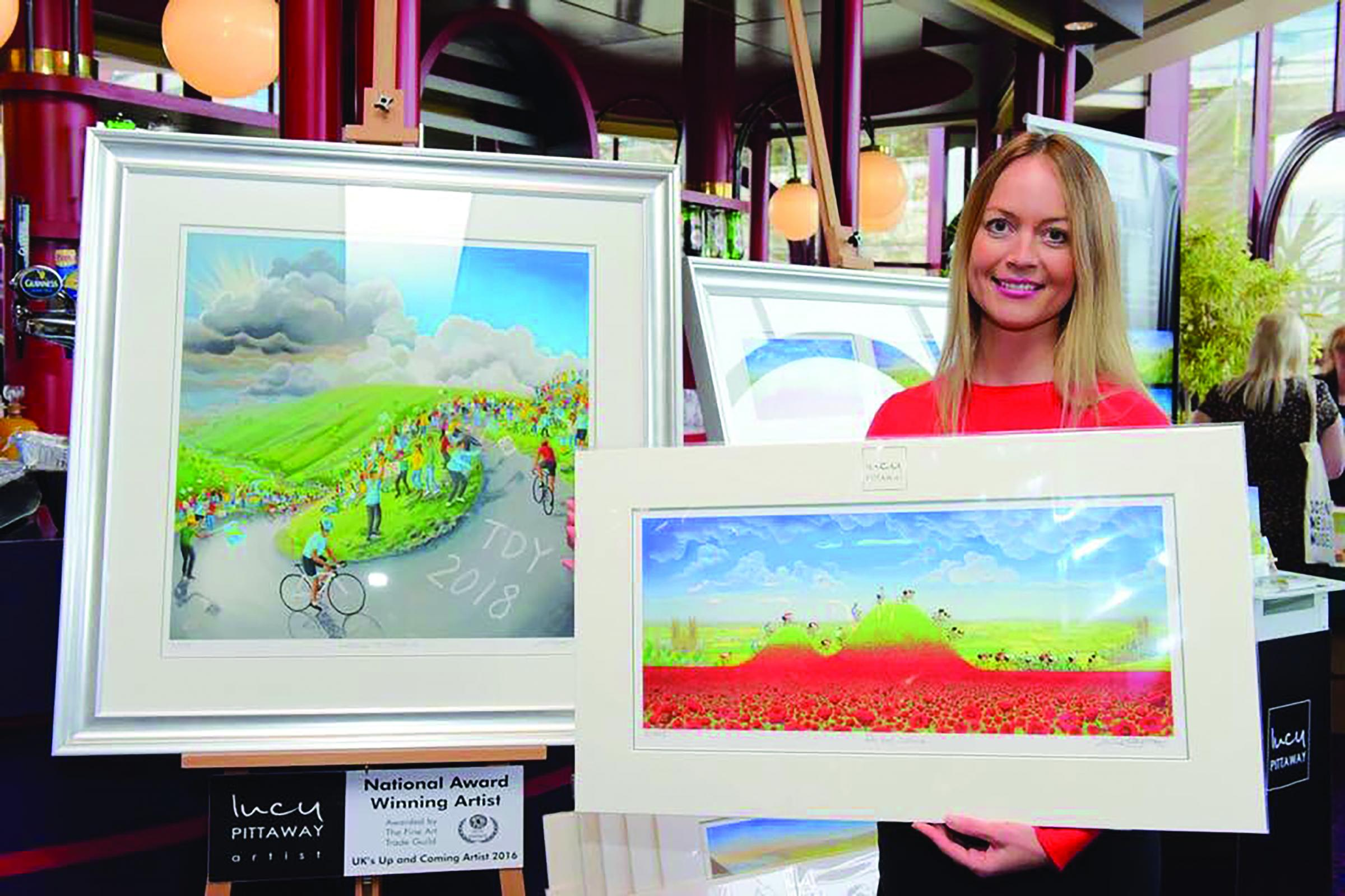 LUCY: The artist with some of her Tour de Yorkshire pictures