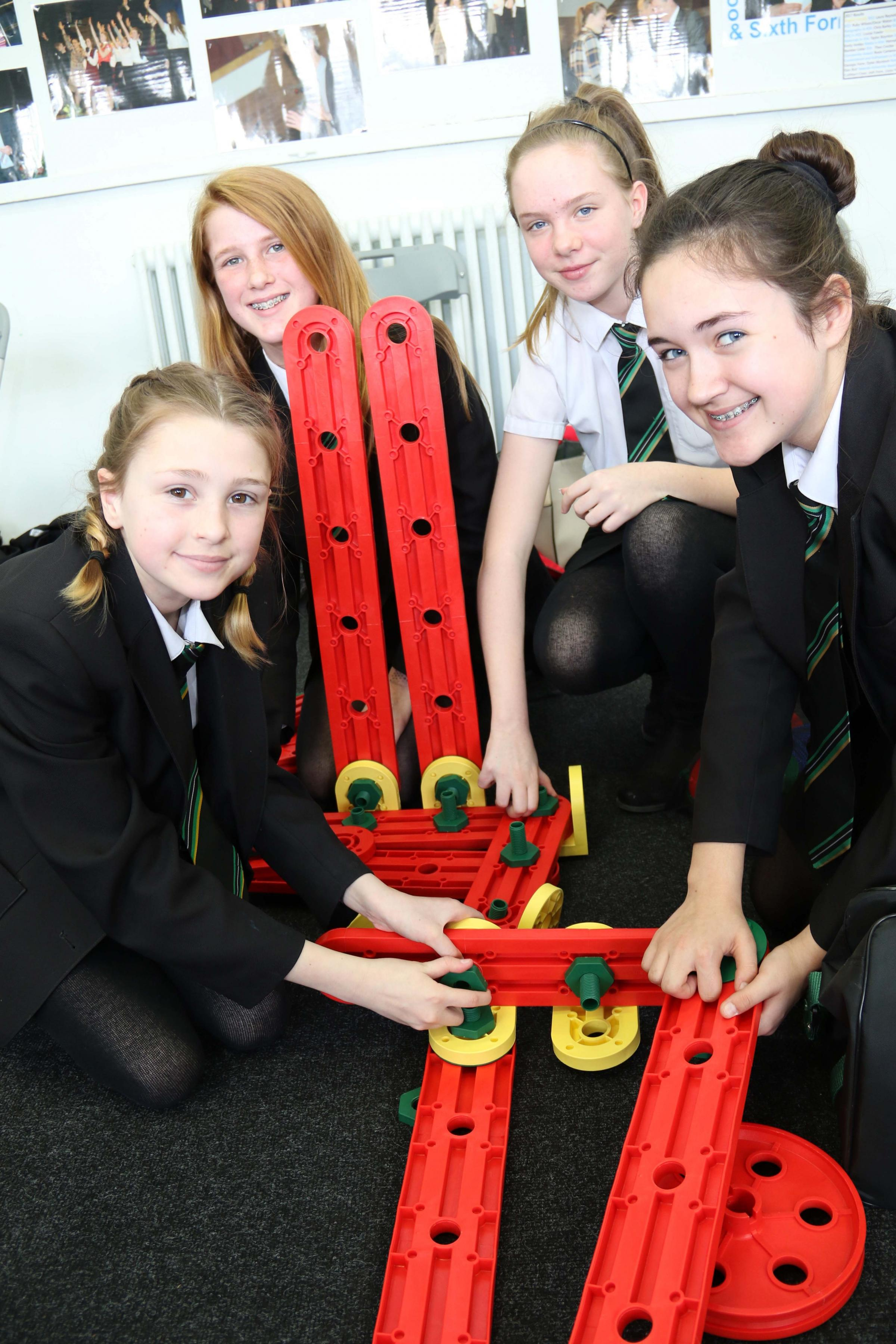 TEAM-BUILDING: From left, Lucy Salkeld, 12, Katie Starkey, 13, Casey Milburn, 13, and Rose Heward, 13, take part in teambuilding exercises organised by the Jon Egging Trust.