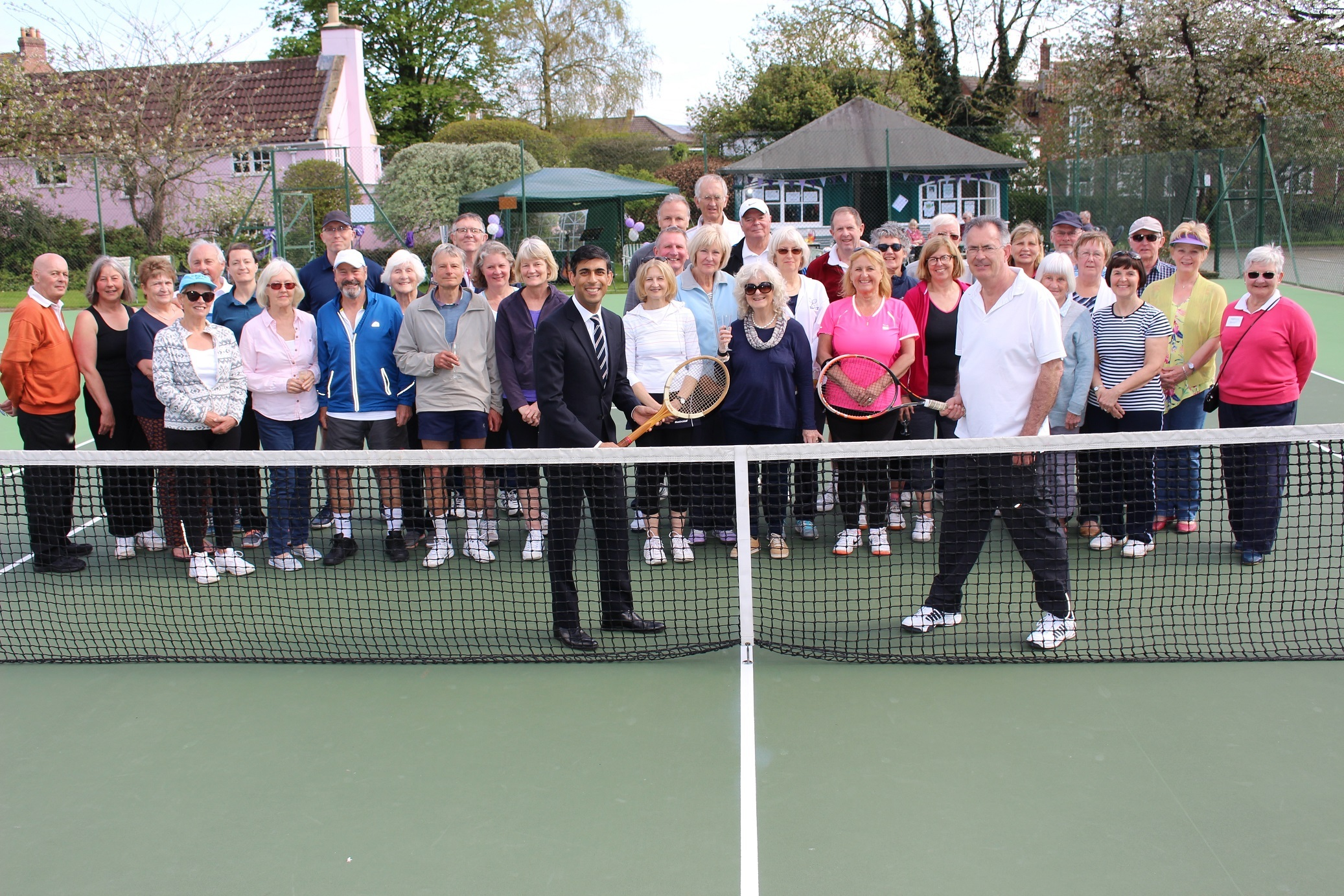 UNGRADE: Rishi Sunak MP with Dr Tim Ryan, chairman of Great Ayton Tennis Club, and club members and supporters on the new courts