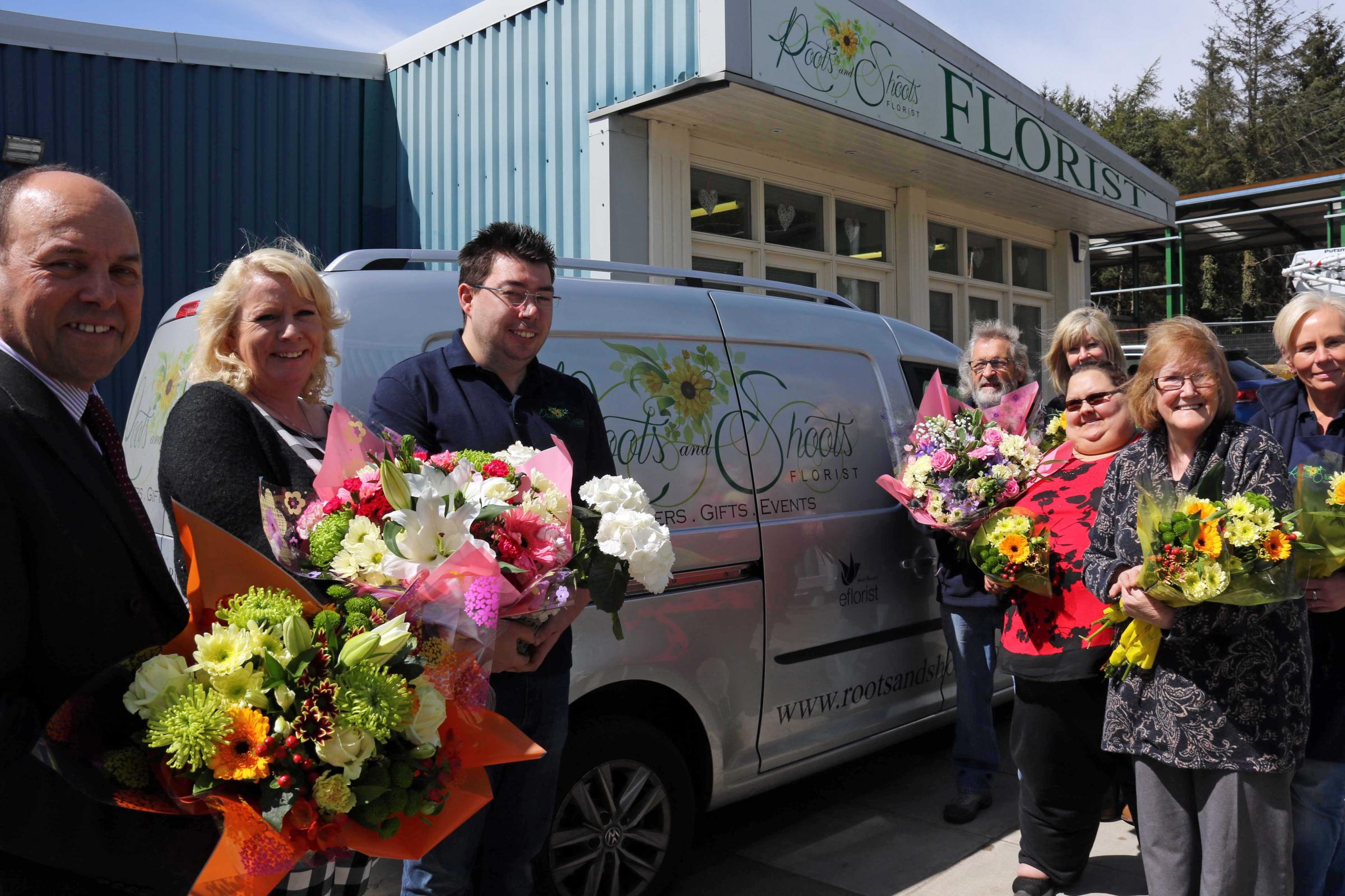 Growing business: (L-R) Tony Luckett of Clive Owen LLP; Karolyn Scott of BHP Law; owner William Gardner; previous owner Norman Bell; florist Debra Redfern; Lizzie Gardner with Angela Bell; and florist Katrina George.