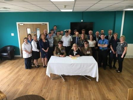 Seated from left: Major Mark Wright, BMI Woodlands Hospital Executive Director Debbie Dobbs and BMI Healthcare's Regional Director of Clinical Services Col Sharon Stewart, with military staff from the hospital, colleagues and representatives of the arme