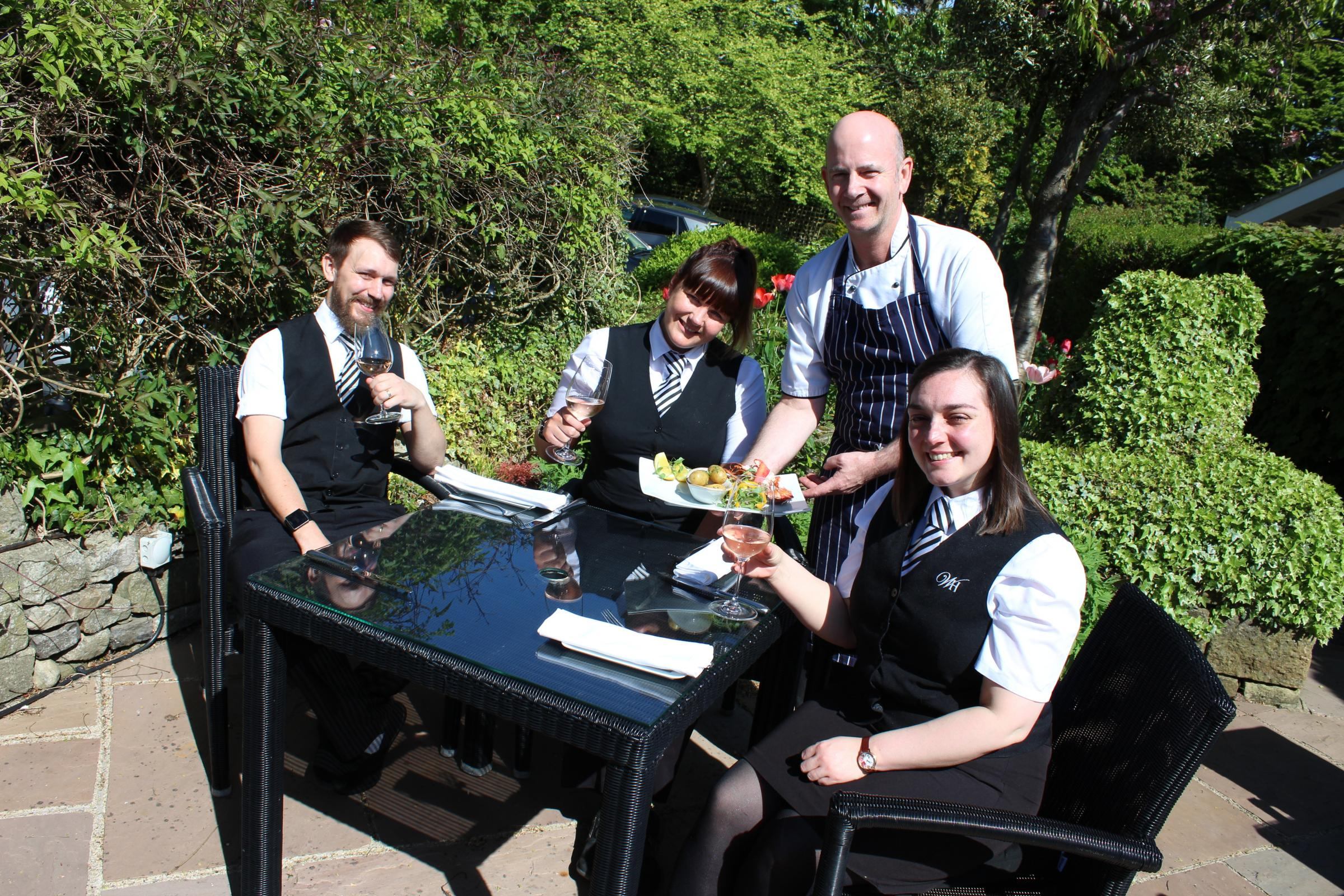 REST: Chef Graeme Moss serves waiters Alex Miles (left) Carly Thompson (middle) and Dee Smith (right).