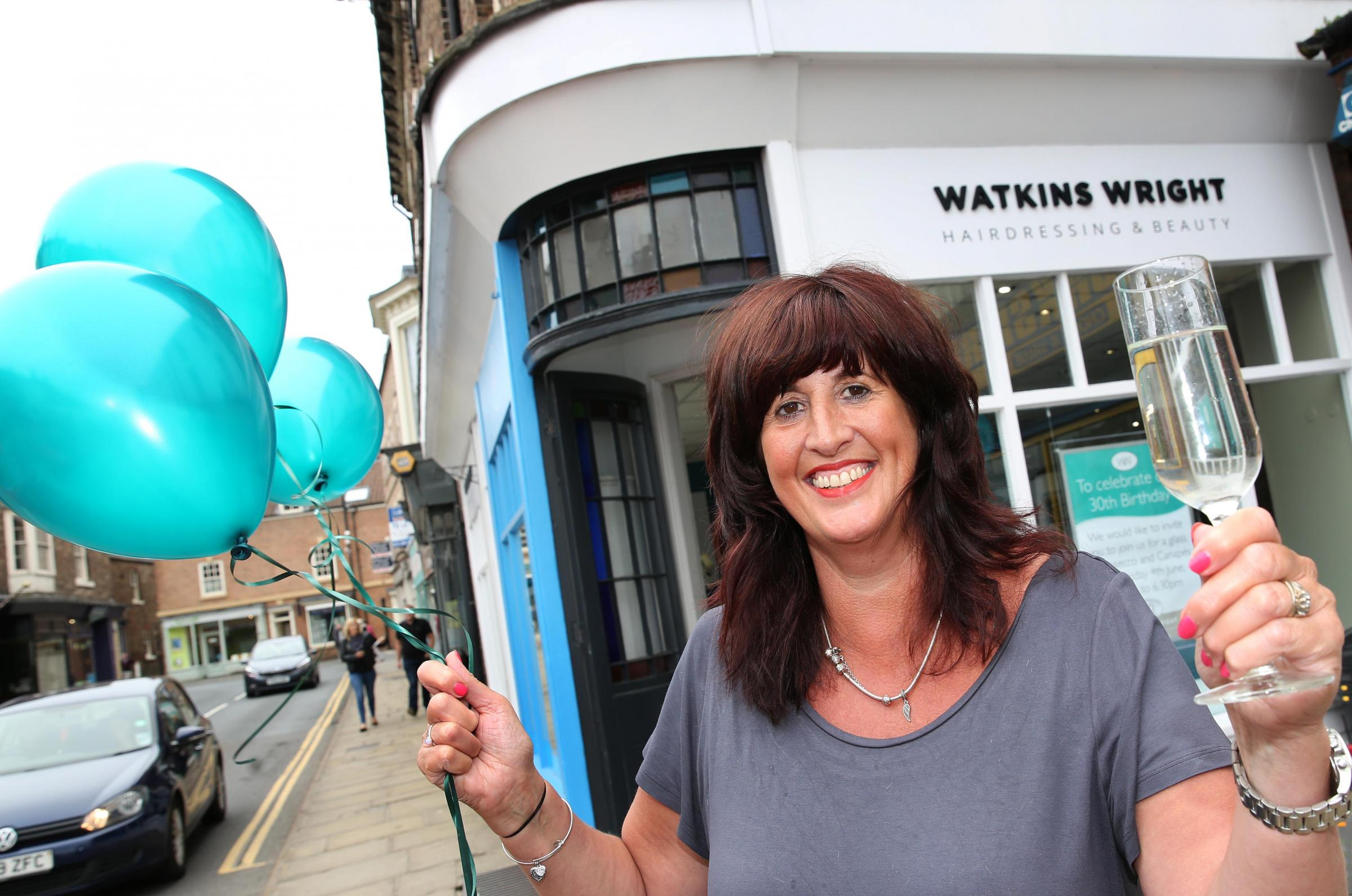 CHEERS: Hairdresser Jill Watkins Wright celebrating 30 years in business. Picture: Richard Doughty Photography