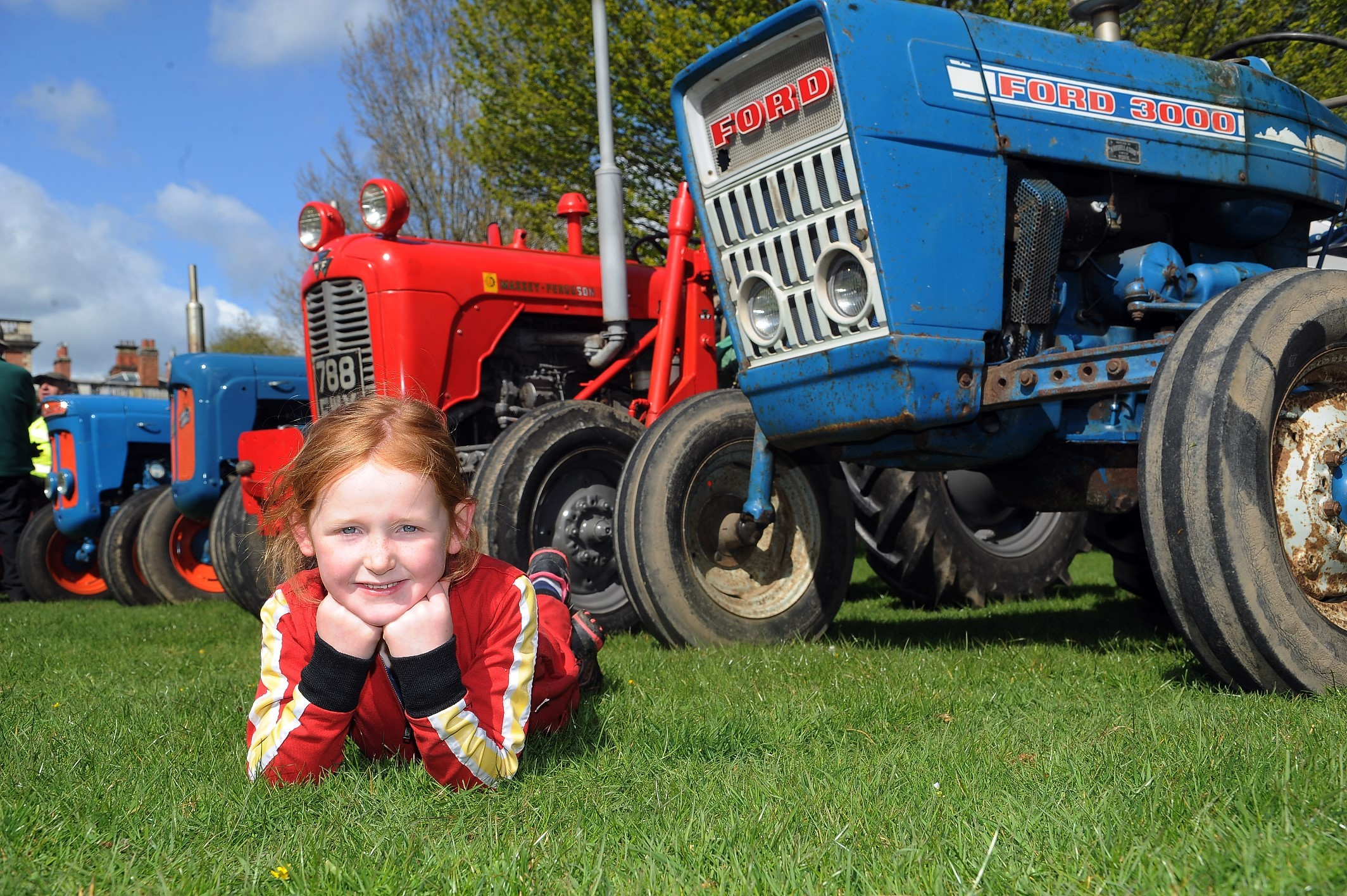 FEST: Young Charlotte Wilson takes a break during this year's Tractor Fest at Newby Hall.