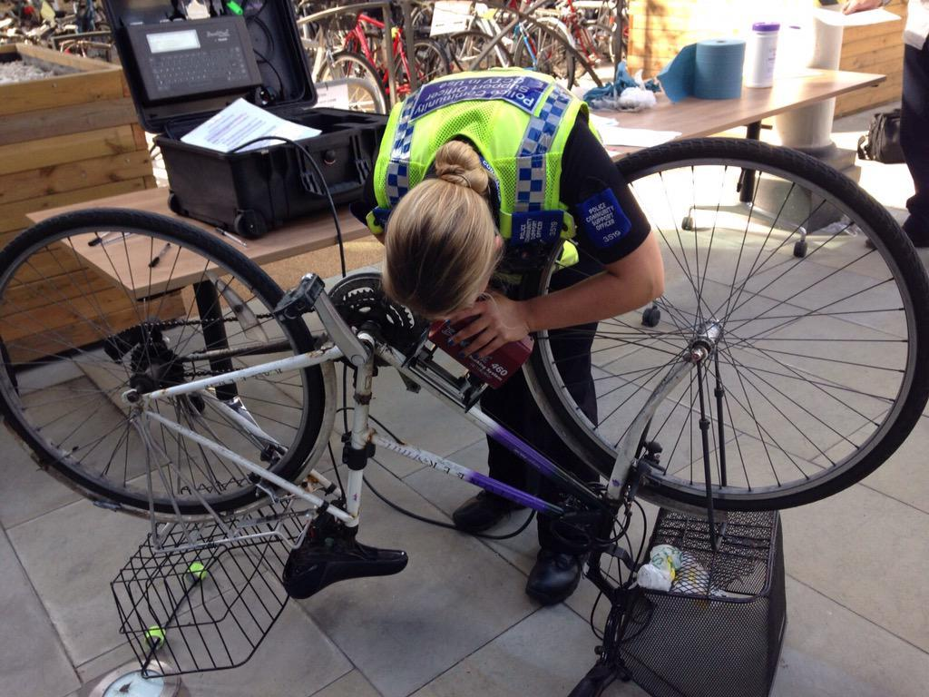 SECURITY: A North Yorkshire Police PCSO security marks a bike with a dot peen machine