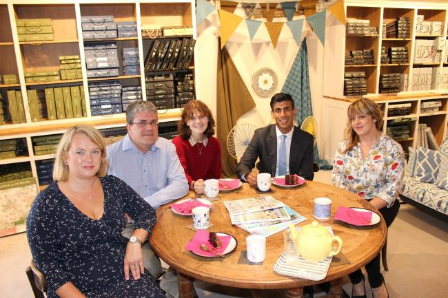 Rishi Sunak with, from left, Leonie, David and Eleanor Garrard and, right, Emma Devine, Milner's business development manager