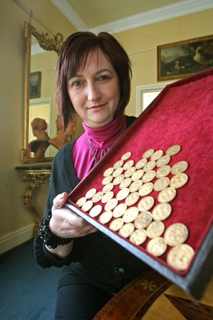 UNDER THE HAMMER: Marie Palliser from Thirsk with the gold coins she discovered with a friend in 1974