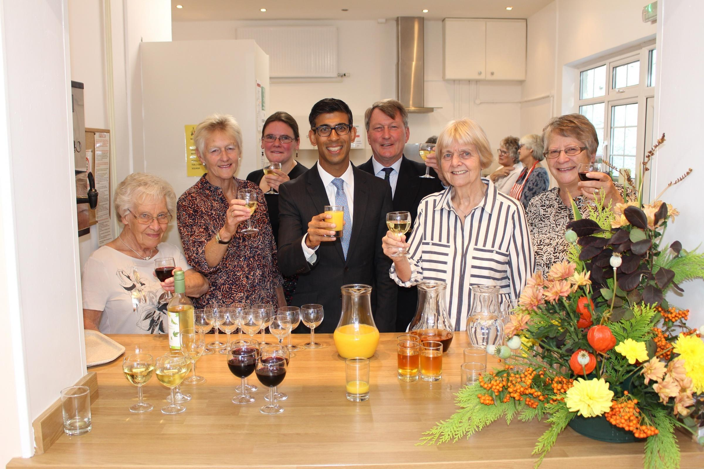 IMPROVED: Rishi Sunak with members of the village hall trustees
