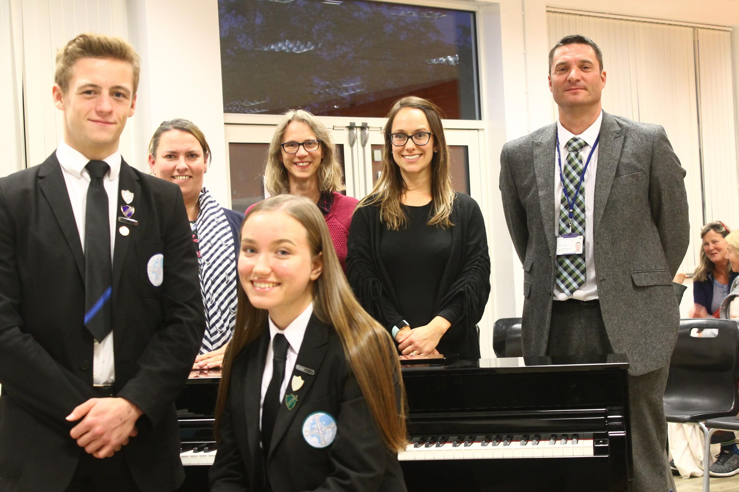 SUPPORT: Head girl and head boy, Hannah Crawford and Ryan Pepper, with (left to right) Liz Shevels, co-director of the Vocal Collective Community Choir; Gill Smith, secretary of the Parents' Forum; Katie Hibbard, co-director of the choir; and Hummmers