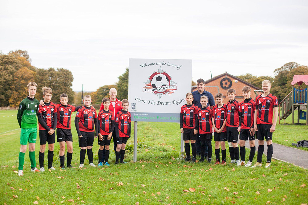 NEW KIT: Heighington AFC under 14s with their coach Arthur Rudd, and Patrick Stephens, director of The Shred Centre