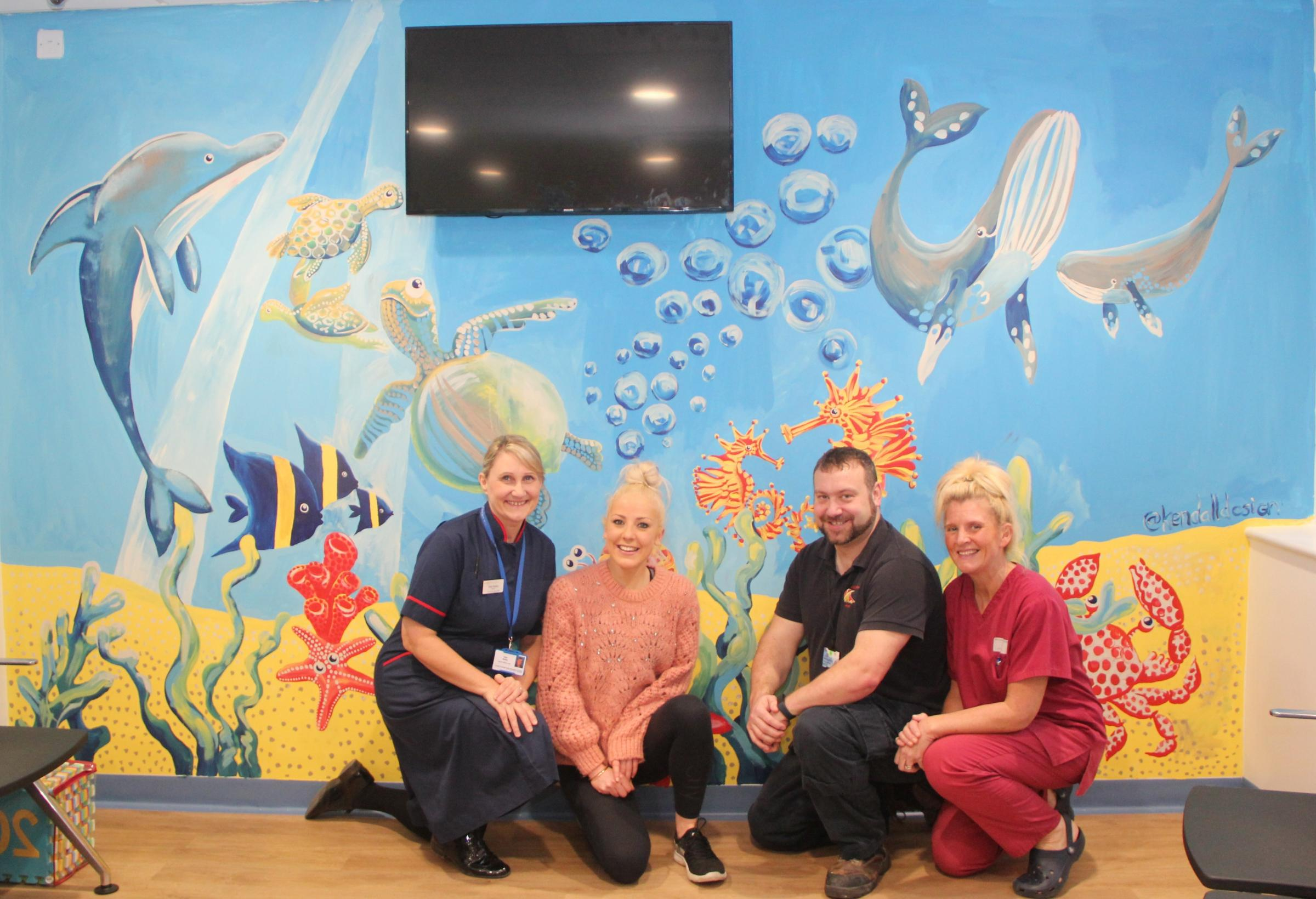 WARD MURAL: Vikki Bailey, matron for the emergency department and urgent treatment centre, artist, Emma Kendall, caretaker Rob Stephenson and Serena Slade, emergency care practitioner