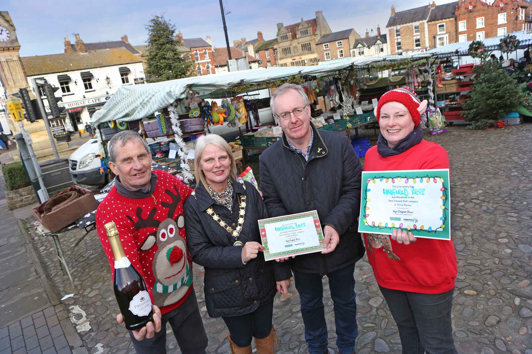 FESTIVE: Phil and Natalie Ibbitson from Hadfield Pets with Mayor of Thirsk, Cllr Hazel Dalgleish-Brown and leader of Hambleton District Council, Cllr Mark Robson