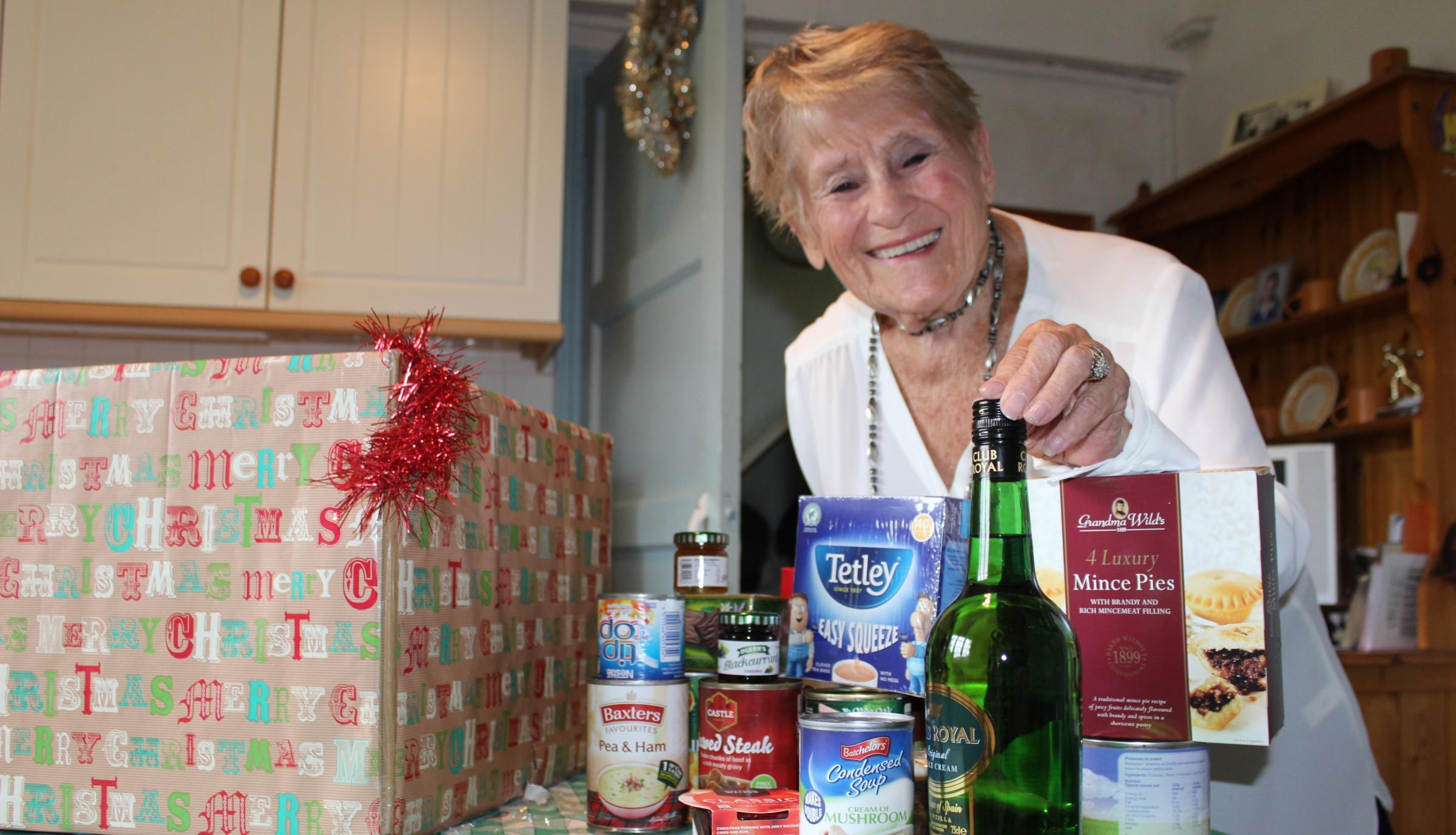 Joan Ackrill, from Oxfordshire, receives her Christmas hamper from RABI