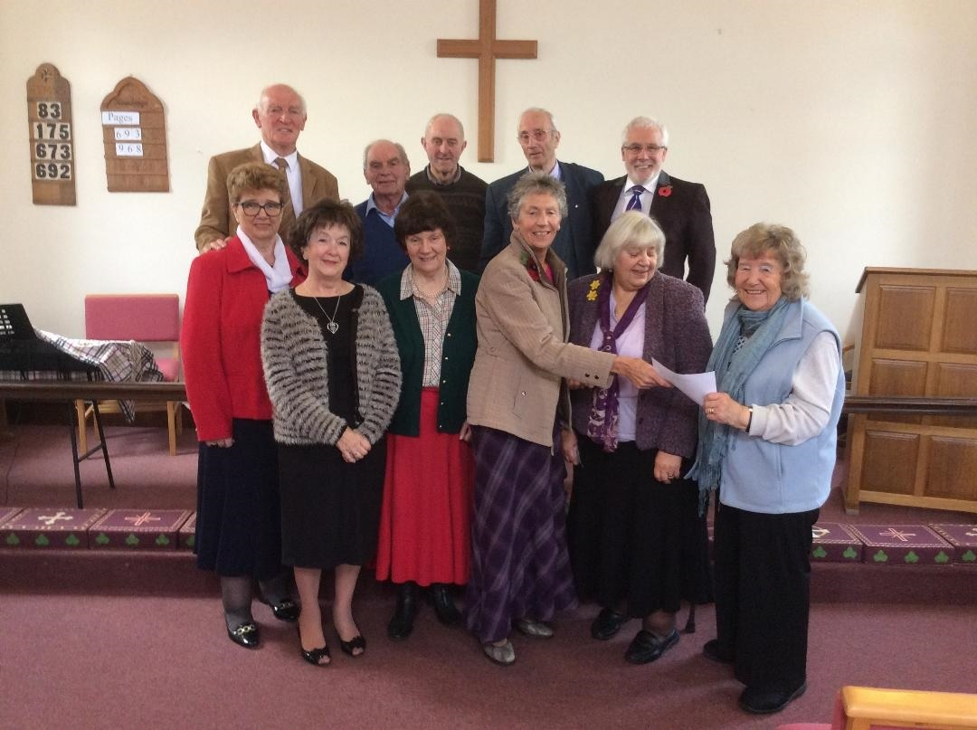 Members of the Methodist chapel in Finghall present a cheque to RABI