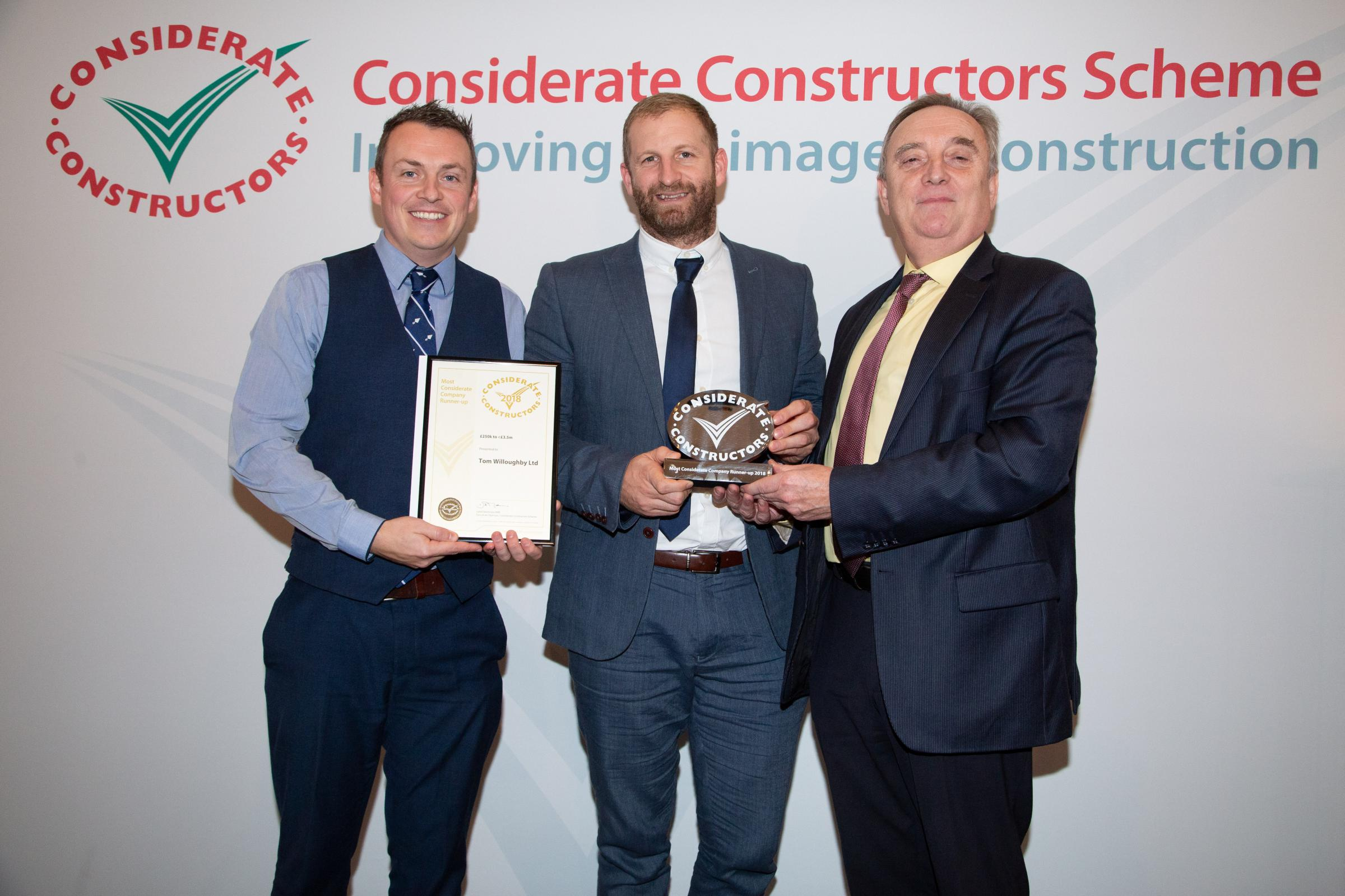 WINNERS … Andrew Blair, left, and Dean Wilson, centre, receive their CCS Award from Shaun McCarthy OBE