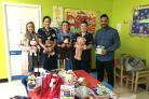 GRATEFUL STAFF: Nurses were handed bags of donated items for their young patients