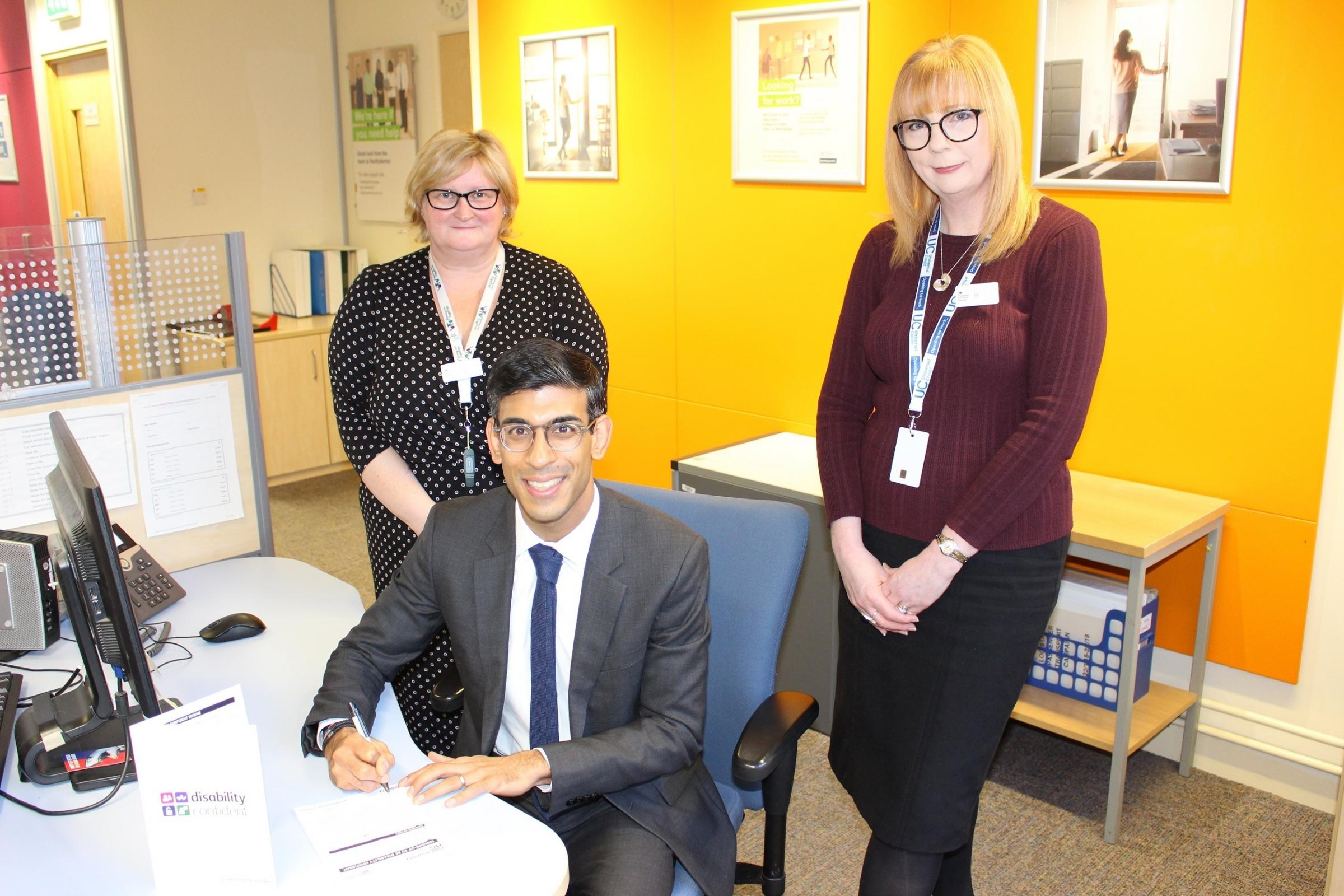 Rishi Sunak signs up as a Disability Confident Committed employer at Northallerton Jobcentre with Jobcentre Manager Liz Sainsbury, right, and Julia Priestnall, Employment and Partnership Manager, Northallerton and Richmond