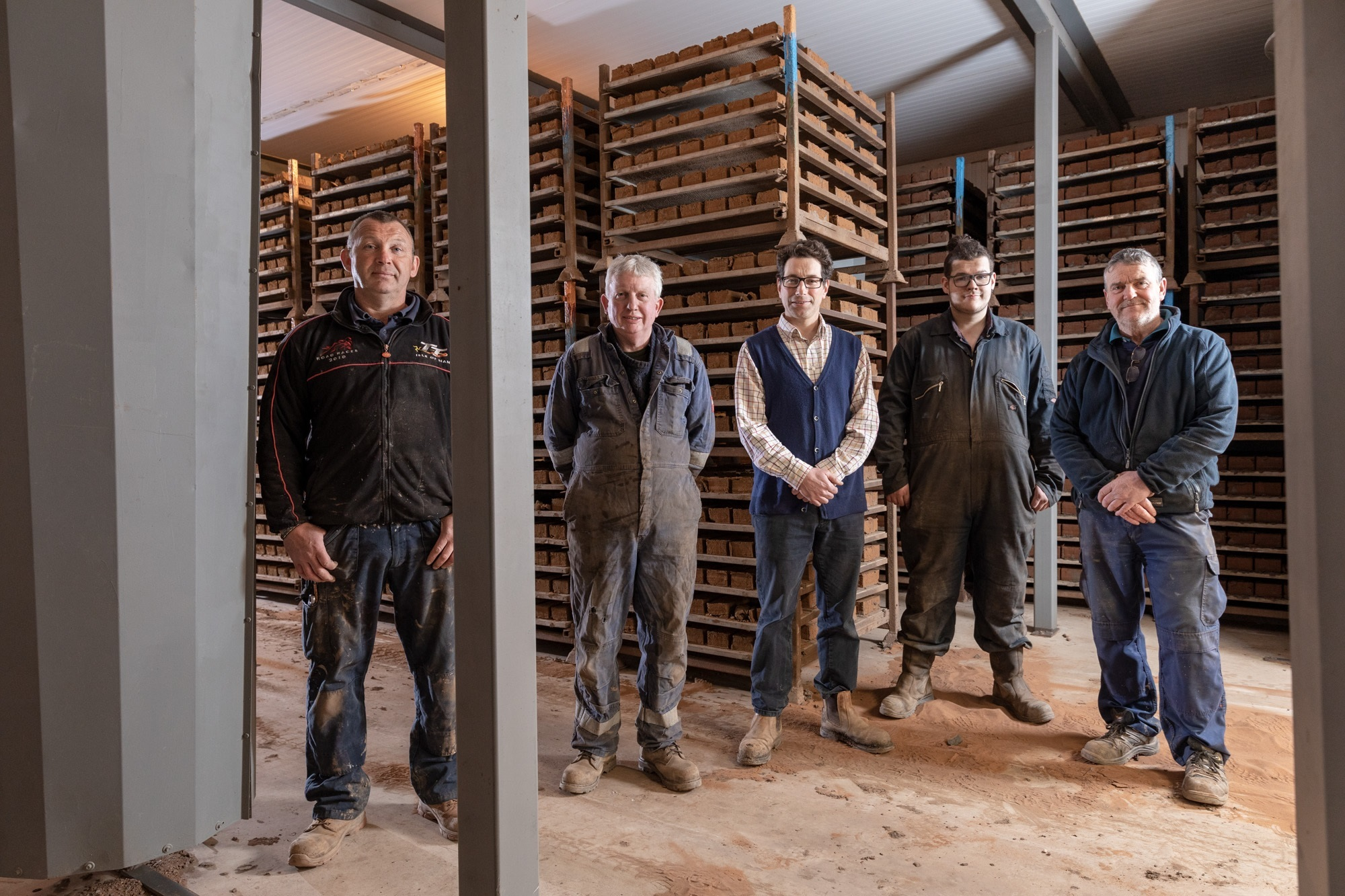 From left, Shaun Richardson; Nick Barker; Guy Armitage; Toby Sanderson; and Steve Pittham in front of the new dryer